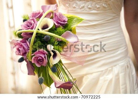 Bride holding her bouquet - stock photo