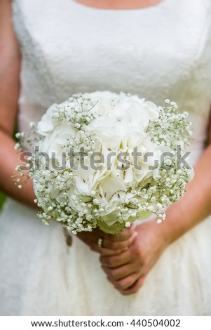 Bride holding Hydrangea, Gypsophila bouquet. Wedding flowers. Bridal white bouquet. Wedding - stock photo
