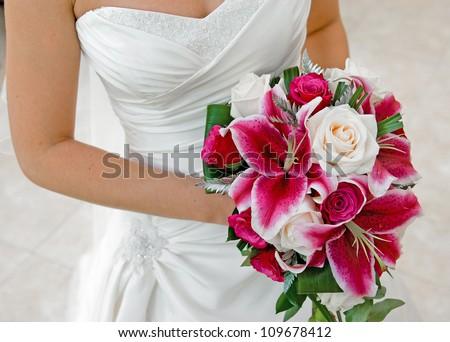 Bride holding wedding bouquet. - stock photo