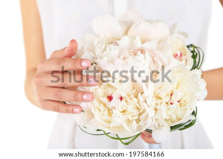 Bride holding wedding bouquet of white peonies, close-up, isolated on white - stock photo