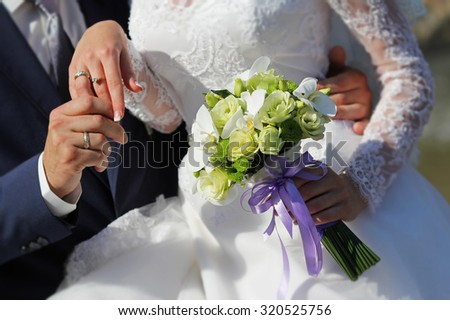 Bride holding wedding bouquet. Wedding rings. Wedding vows. - stock photo