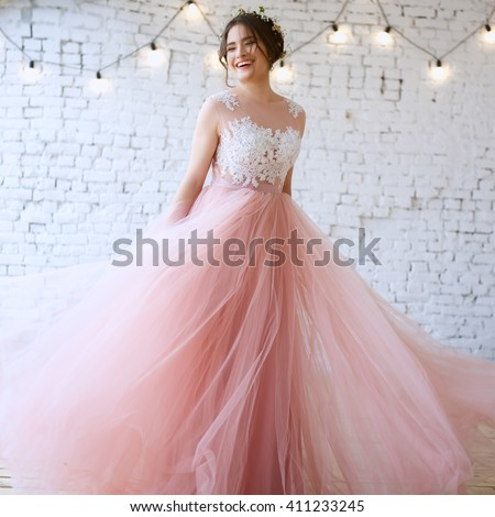 Bride tender light pink wedding dress stock photo 411233245 bride in a tender light pink wedding dress in a morning fashion beauty portrait junglespirit Images