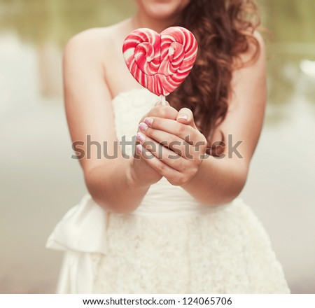 bride in a white dress with a wedding bouquet in park - stock photo