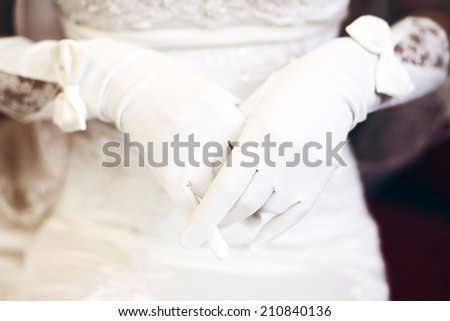 Bride in beautiful gloves, white lace dress - stock photo