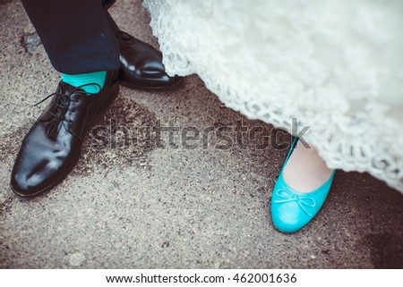 Bride in blue shoes and groom in blue socks
