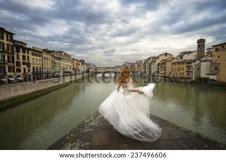Bride in Florence. Ponte vecchio. Italy - stock photo