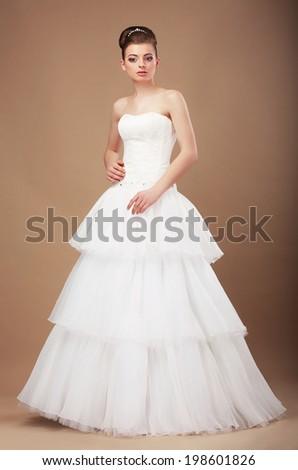 Bride in Long Wedding Dress posing - stock photo