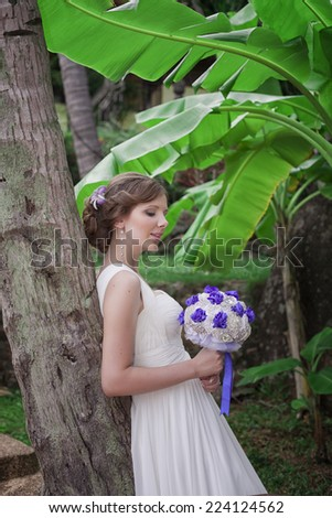 Bride in magic tropikal garden, Thailand - stock photo