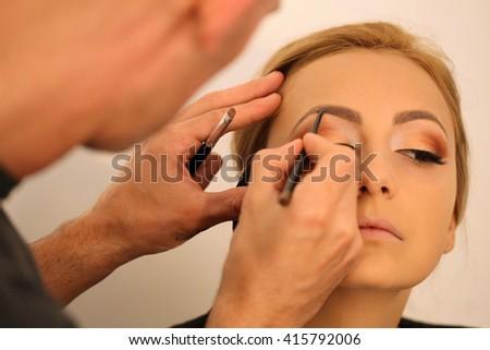 bride in make up artist studio - stock photo