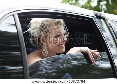 Bride in the car - stock photo