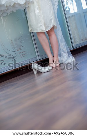 Bride in the weil with her shoes