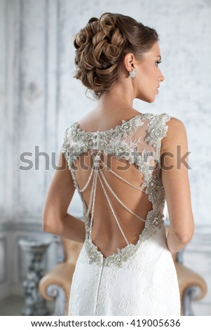 Bride in wedding dress in his apartment in Paris. The girl in a wedding dress in luxurious suites. Wedding dress in Paris. Bride in a luxury apartment in a wedding dress. - stock photo