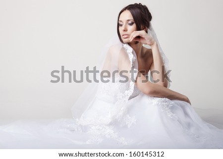 Bride in wedding dress in studio - stock photo