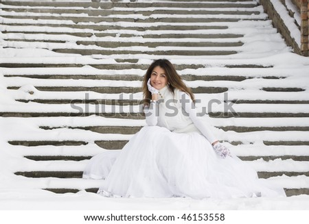 Bride in winter near the stair - stock photo