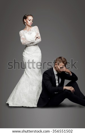 bride leave groom alone on wedding day - stock photo
