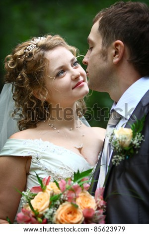 Bride looking in groom's eyes with love - stock photo