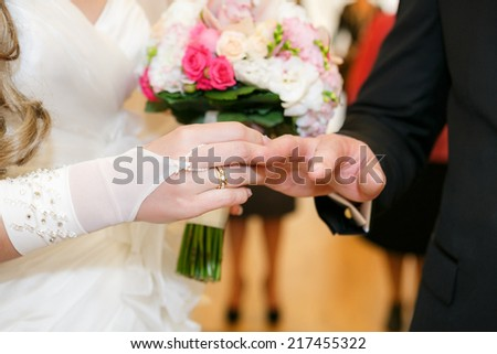 bride newlyweds wears ring groom at a wedding couple - stock photo