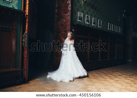 Bride next to the beautiful wooden arch - stock photo