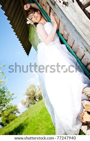 Bride posing showing  wedding dress - stock photo