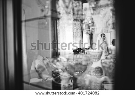Bride reflection in the mirror. B&W photo
