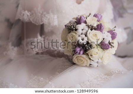 bride's hands on a white wedding dress - stock photo