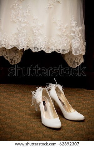 Bride's shoes and dress - stock photo
