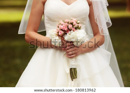 Bride's  wedding bouquet with hortensia and roses - stock photo