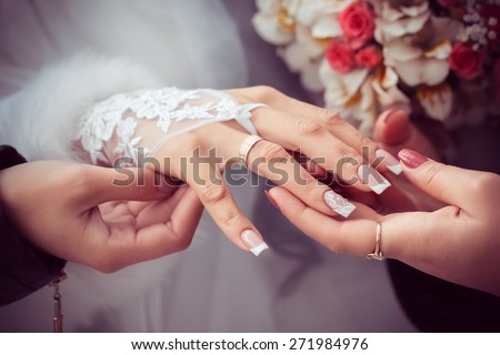 bride shows the wedding ring to girlfriends - stock photo
