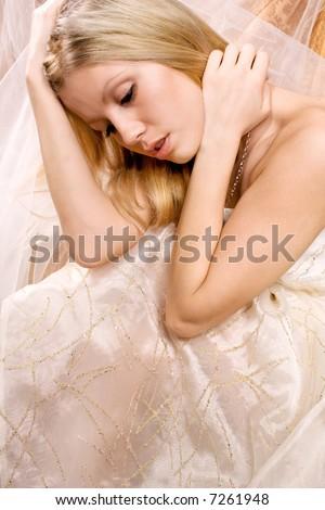 bride sitting wedding dress, studio shot - stock photo