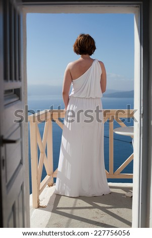 Bride standing back and enjoying sun on the tropic island  - stock photo