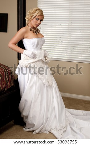 Bride Striptease Series #4 - stock photo