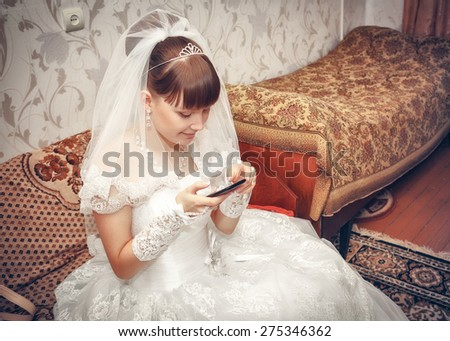 bride talking over cell phone - stock photo