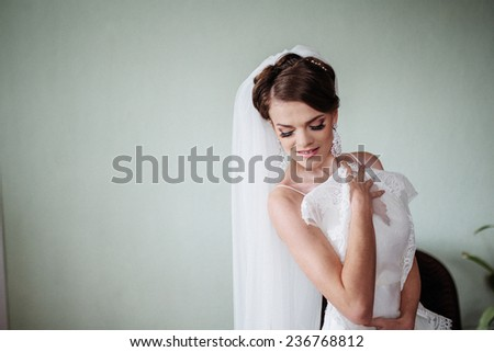 Bride trying on dress - stock photo
