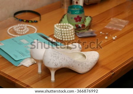 bride wedding shoes are on the table