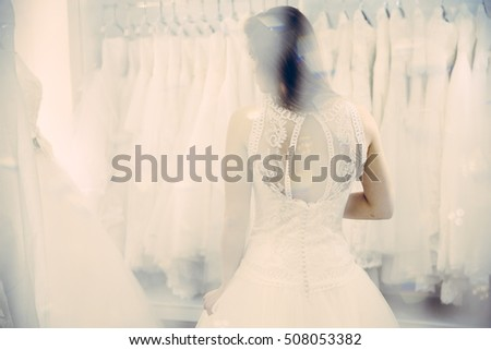 Bride white wedding dress from back, shallow focus vintage