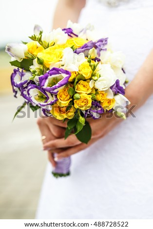 bride with a bouquet of flowers in their hands