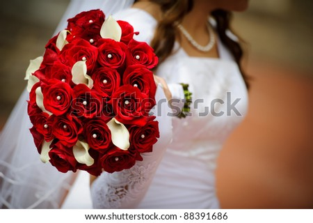 Bride with a wedding bouquet - stock photo