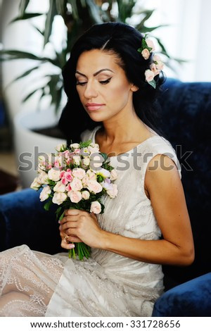Bride with a wedding bouquet in the background Interior