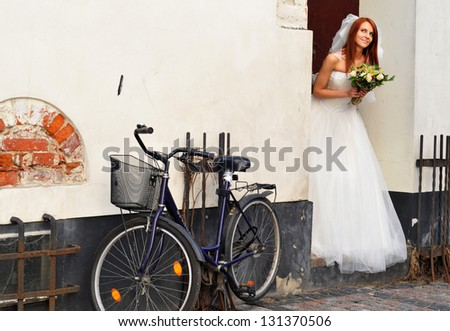 Bride with bicycle - stock photo
