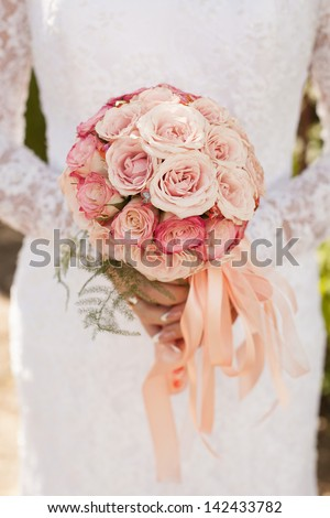 Bride with bouquet, closeup - stock photo