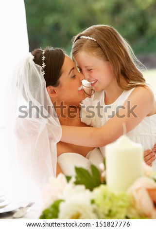 Bride With Bridesmaid In Marquee At Reception - stock photo