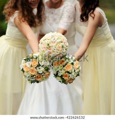 bride with bridesmaid with bouquets