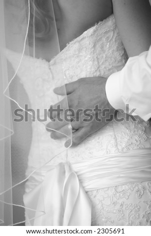 Bride with hand on her back - stock photo