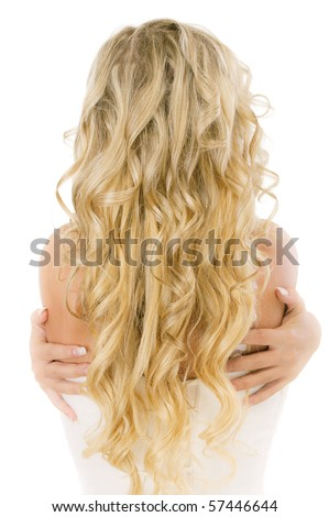Bride with long fair hair from back, isolated on white background.