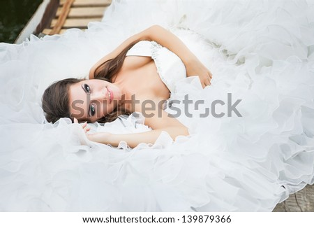 bride with long hair lying down - stock photo