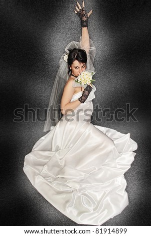 Bride with the bouquet against the dark background