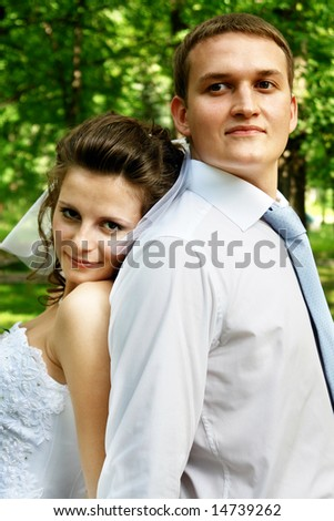 Bride with the groom on the forest background