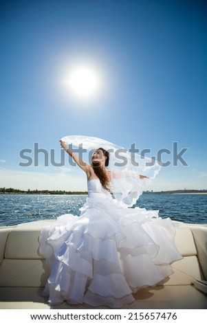 bride with veil in the boat - stock photo