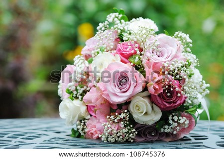 Brides bouquet of pink and white roses before wedding - stock photo