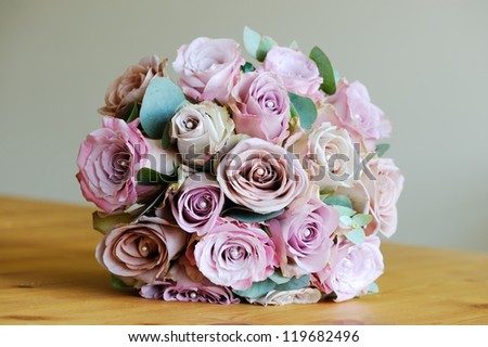 Brides bouquet of pink roses on wedding day